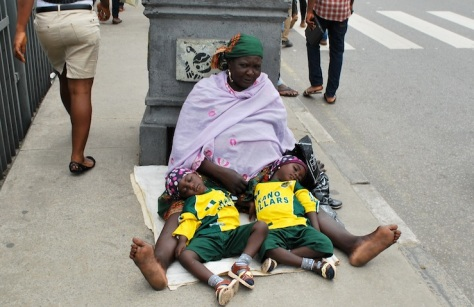 An old woman begging with little children at Marina Street, Lagos. PHOTOS: AYODELE ADENIRAN